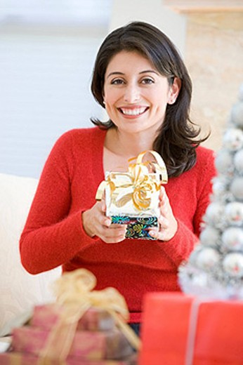 Woman Excited To Open Christmas Present : Stock Photo