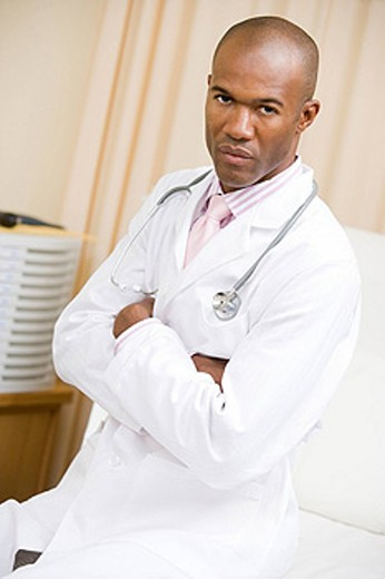 A Doctor Sitting On A Hospital Bed : Stock Photo