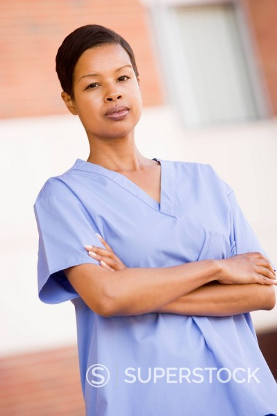 Stock Photo: 1888R-18993 Nurse Standing Outside A Hospital