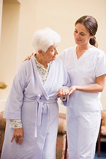 Stock Photo: 1888R-19161 Nurse Helping Senior Woman To Walk