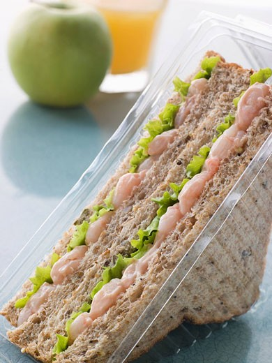 Prawn Marie Rose And Salad Sandwich On Granary Bread With An Apple And Orange Juice : Stock Photo