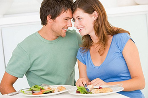 Young Couple Enjoying meal,mealtime Together : Stock Photo