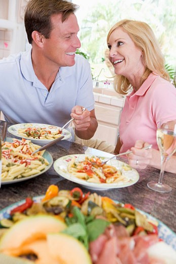Couple Enjoying meal,mealtime Together : Stock Photo