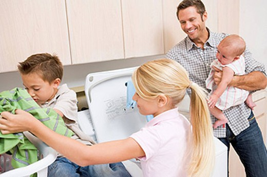 Father And Children Doing Laundry : Stock Photo