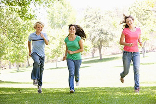 Stock Photo: 1888R-20490 Teenagers Running Through Park