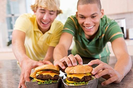 Teenage Boys Eating Burgers : Stock Photo