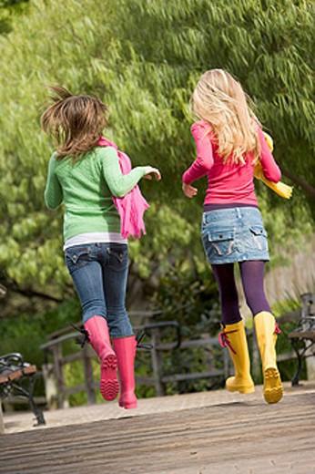 Pair Of Teenage Girls Jogging In Park : Stock Photo