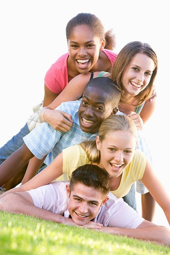 Stock Photo: 1888R-20670 Group Of Teenagers Having Fun Outdoors