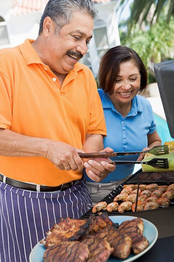 Couple Cooking On A Barbeque : Stock Photo