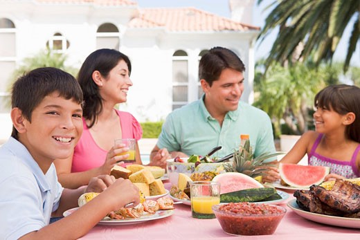 Family Enjoying A Barbeque : Stock Photo