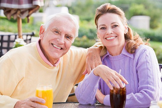 Couple Enjoying A Beverage By A Golf Course : Stock Photo