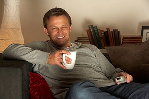 Man Relaxing With Coffee And Television : Stock Photo