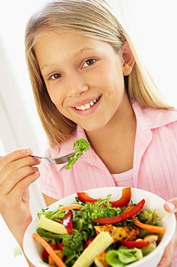 Young Girl Eating Fresh Salad : Stock Photo