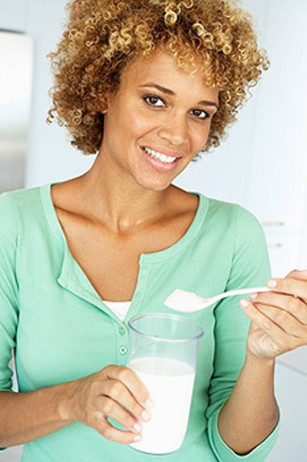 Stock Photo: 1888R-21589 Mid Adult Woman Holding Dietary Supplements