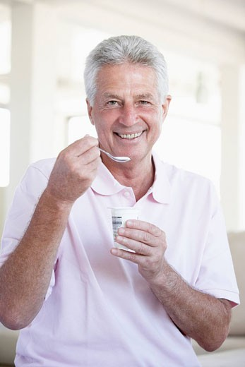 Middle Aged Man Eating Yogurt : Stock Photo