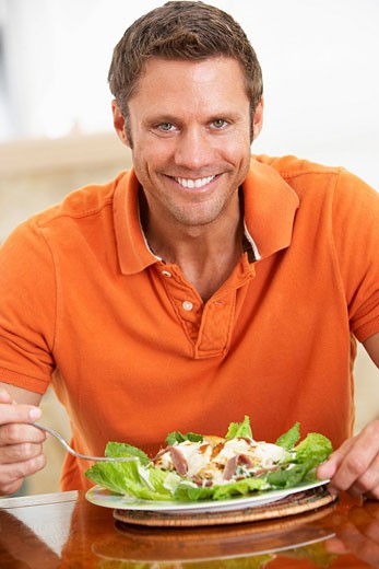 Middle Aged Man Eating A Healthy Meal : Stock Photo