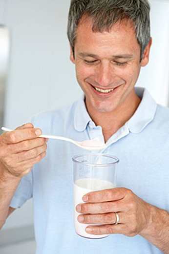 Middle Aged Man Preparing A Dietary Supplement : Stock Photo