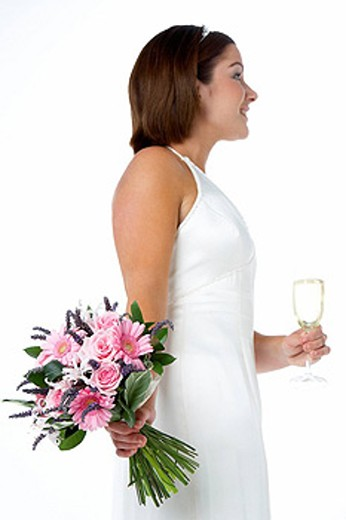 Portrait Of Bride Holding Bouquet And Wine Glass : Stock Photo