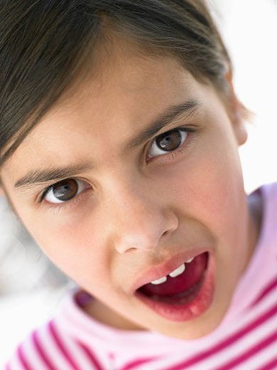 Stock Photo: 1888R-22240 Portrait Of Girl Looking Surprised