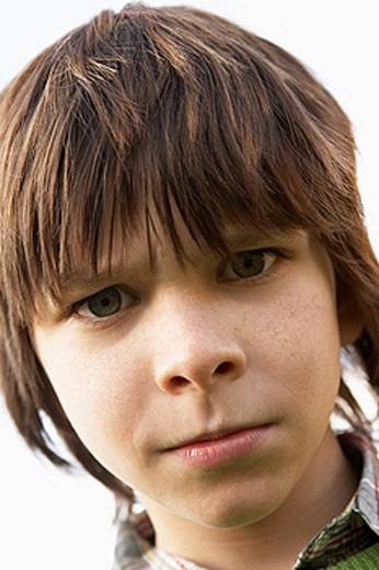 Portrait Of Boy Frowning : Stock Photo