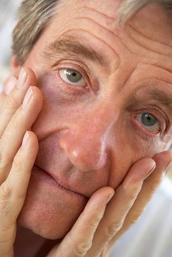 Stock Photo: 1888R-22504 Portrait Of Senior Man Looking Worried