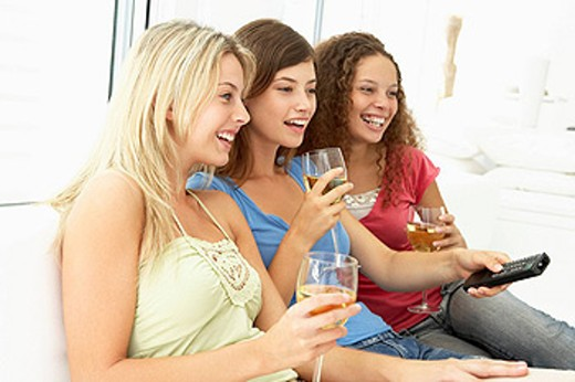 Stock Photo: 1888R-22597 Female Friends Watching Television Together