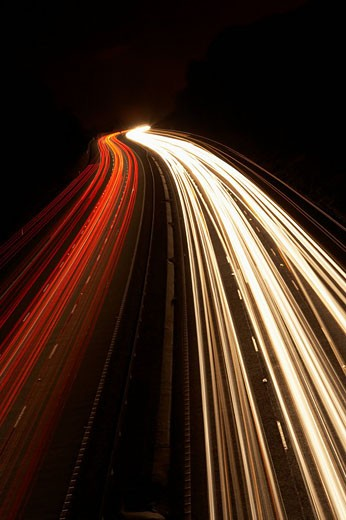 Stock Photo: 1888R-23314 Headlights And Tail Lights On A Motorway At Night