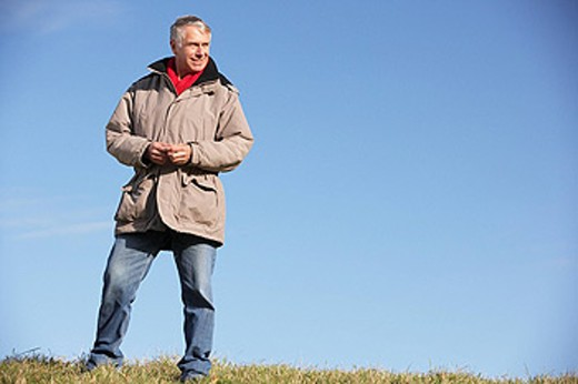 Senior Man Standing In Park : Stock Photo