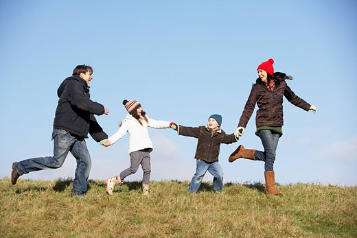 Family Running In The Park : Stock Photo