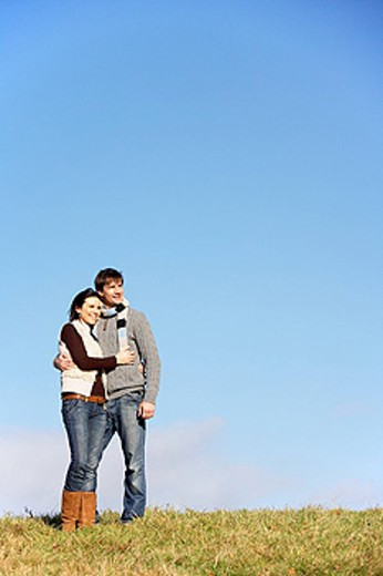 Couple Standing In The Park : Stock Photo