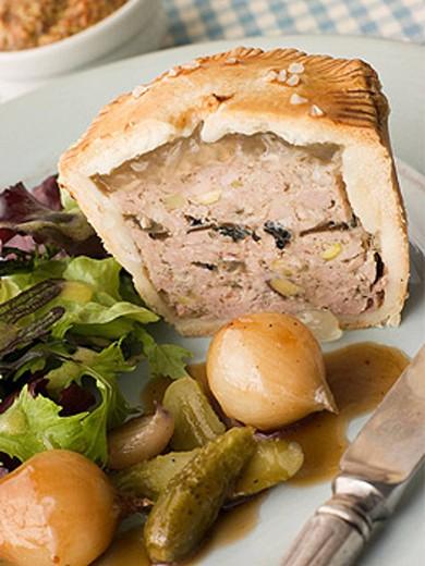 Pork Black Truffle and Pistachio Pie with Glazed Button Onions and Cornichons : Stock Photo