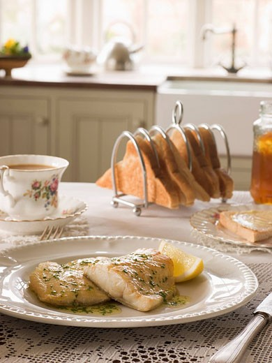 Smoked Haddock with Herb Butter and Toast : Stock Photo