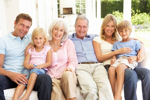Stock Photo: 1888R-24181 Extended Family Relaxing Together On Sofa