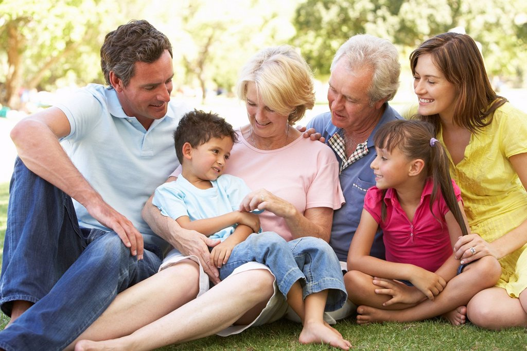Stock Photo: 1888R-24394 Extended Group Portrait Of Family Enjoying Day In Park