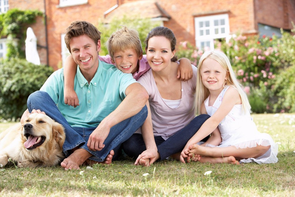 Stock Photo: 1888R-25228 Family Sitting In Garden Together