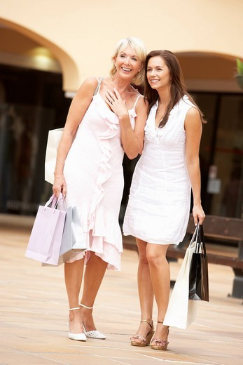 Senior Mother And Daughter Enjoying Shopping Trip Together : Stock Photo