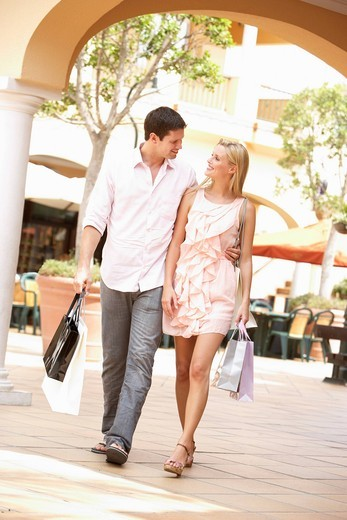 Stock Photo: 1888R-25439 Couple Enjoying Shopping Trip Together