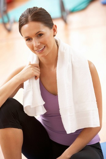 Stock Photo: 1888R-25550 Woman Resting After Exercises In Gym