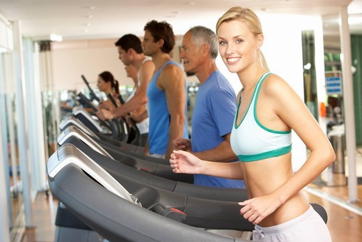 Woman On Running Machine In Gym : Stock Photo