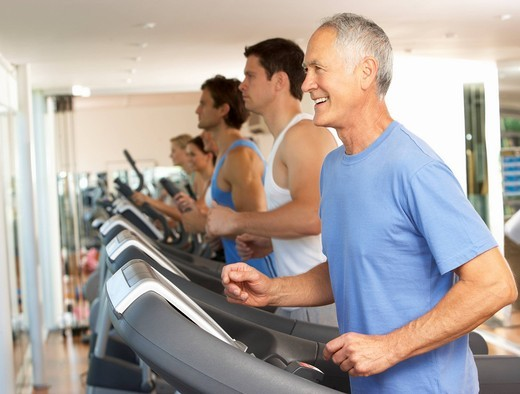 Senior Man On Running Machine In Gym : Stock Photo