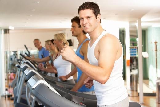 Man On Running Machine In Gym : Stock Photo