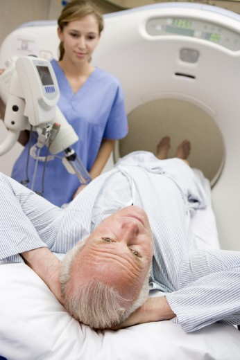 Nurse With Patient As They Prepare For A Computerized Axial Tomography (CAT) Scan : Stock Photo