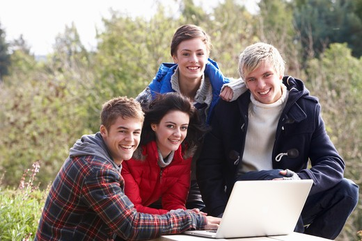 Students with laptop computer : Stock Photo