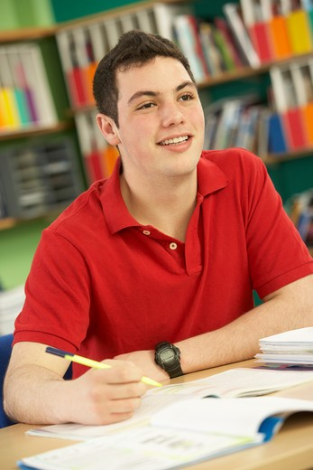 Stock Photo: 1888R-39344 Teenage Male Student In Working In Classroom