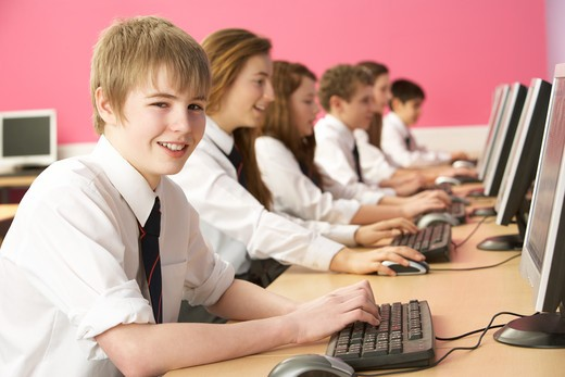 Teenage Students In IT Class Using Computers In Classroom : Stock Photo