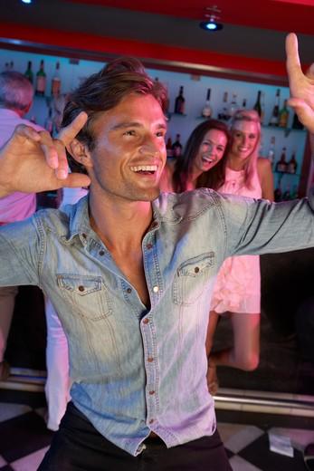 Young Man Having Fun In Busy Bar : Stock Photo