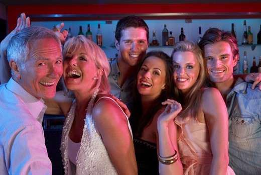 Group Of People Having Fun In Busy Bar : Stock Photo