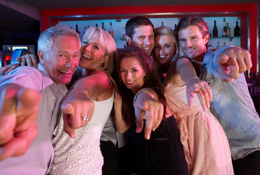 Stock Photo: 1888R-39743 Group Of People Having Fun In Busy Bar
