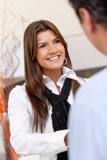 Stock Photo: 1888R-40809 Business woman handshaking with an other person