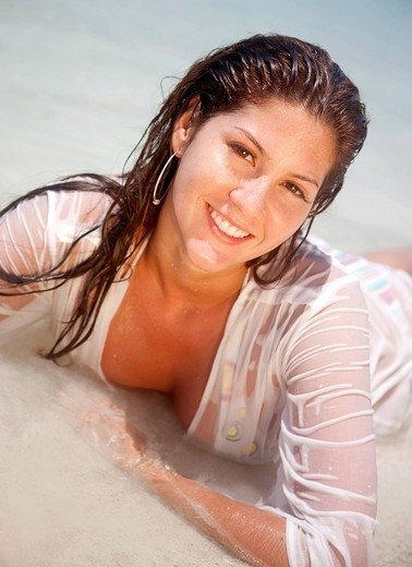 Sexy woman at the beach with a wet t_shirt. : Stock Photo